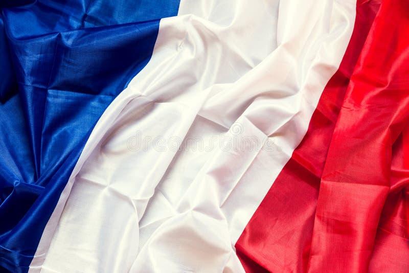 与copyspace的起皱纹的法国旗子 图库摄影
