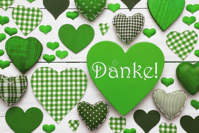 与Danke手段的绿色心脏纹理感谢您 免版税库存图片