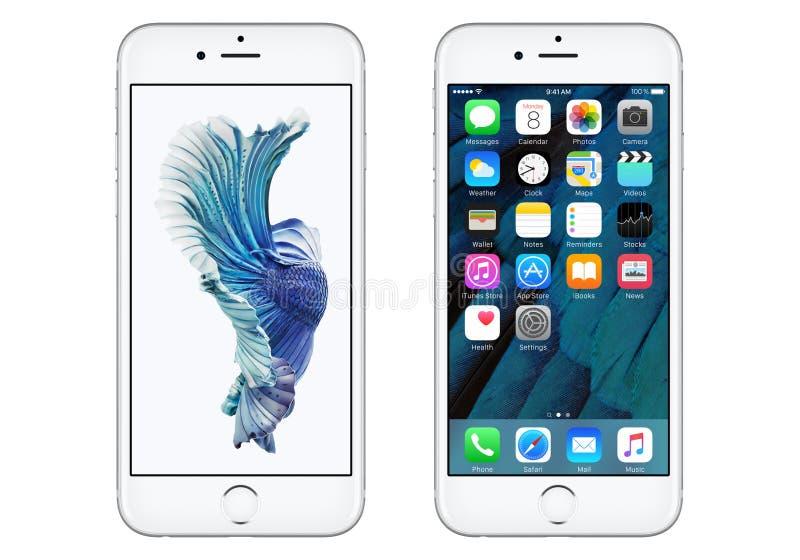 与iOS 9和动态墙纸的白色苹果计算机iPhone 6S 库存图片