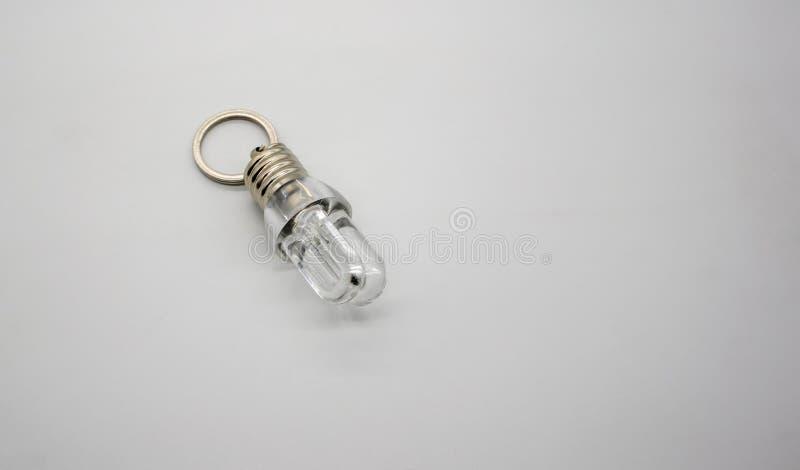 与U形状keychain的LED手电微型电灯泡隔绝在白色 免版税库存图片
