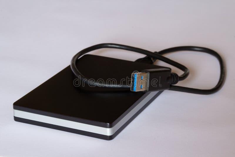 与USB缆绳的简单的外在硬盘 免版税库存照片