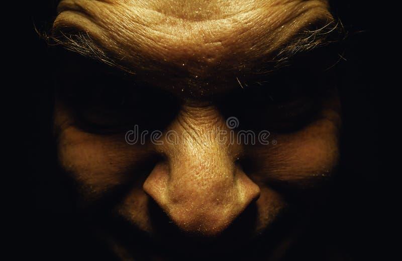 丑恶的男性面孔 免版税图库摄影