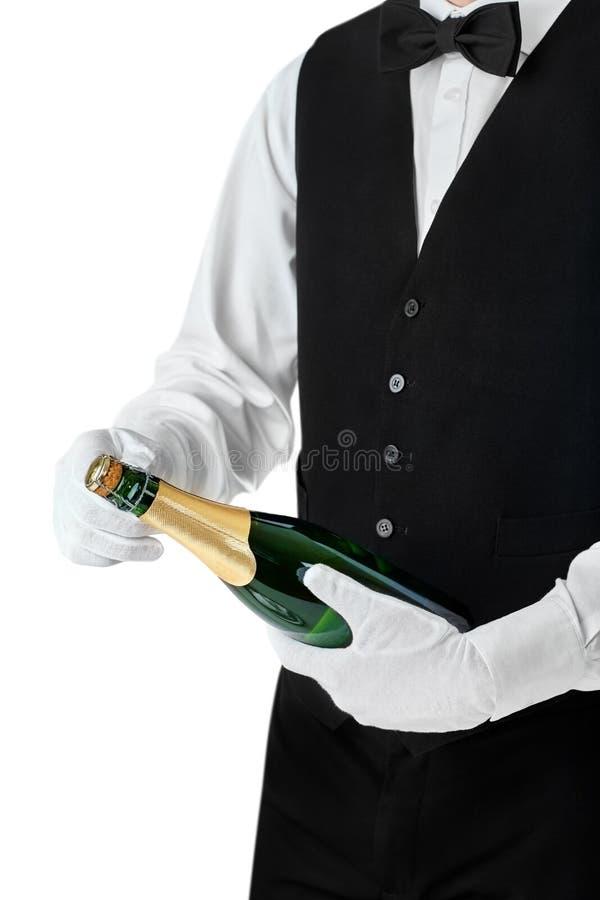 专业侍者开头瓶香槟 库存图片