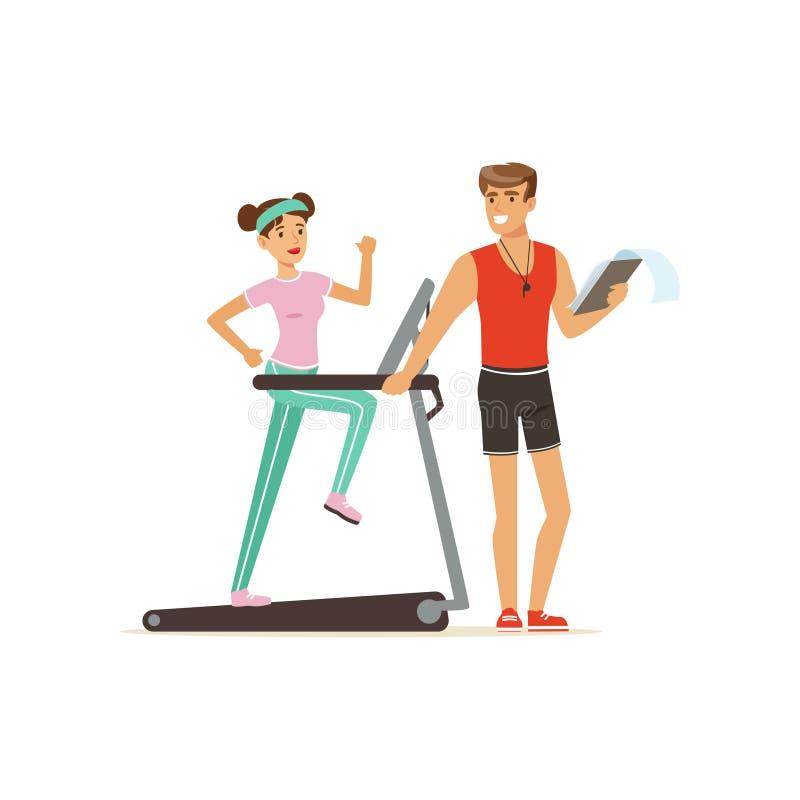 专业健身教练和少妇跑在螺纹磨房的,行使在个人教练员下控制的人们  皇族释放例证
