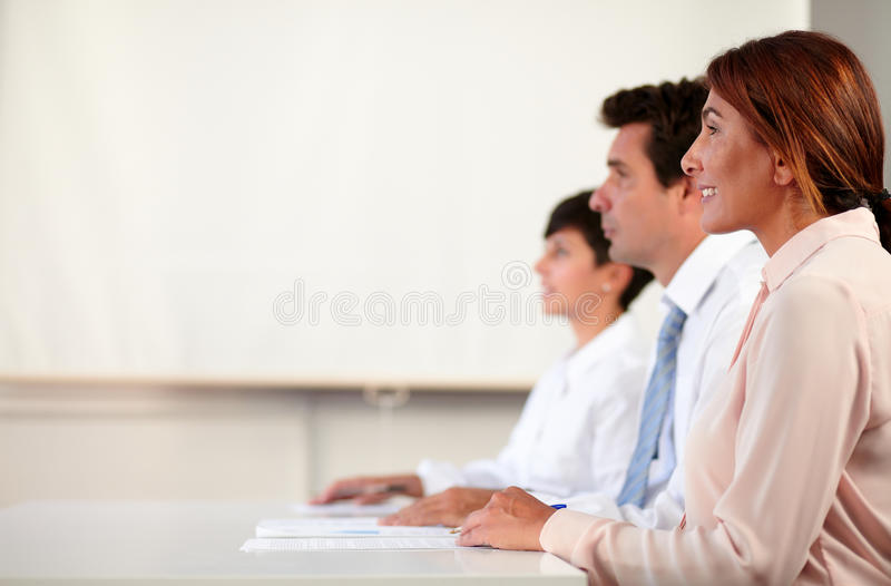 专业成人企业队听的会议 免版税库存图片
