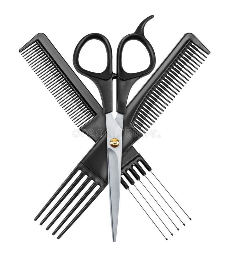 专业美发师剪刀和两把梳子 图库摄影