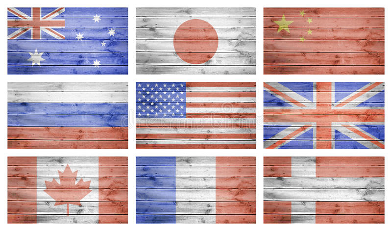 世界下垂在木板条纹理的拼贴画 免版税图库摄影