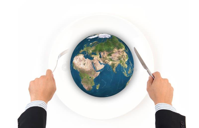 世界与叉子的地球球和刀子,这张图象毛皮的元素 库存图片