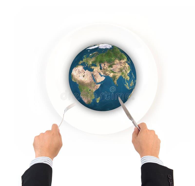 世界与叉子的地球球和刀子,这张图象毛皮的元素 免版税库存图片