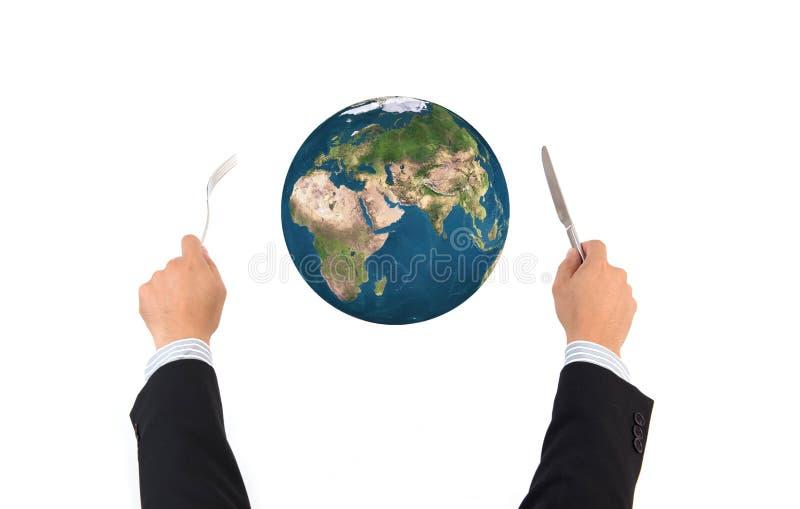 世界与叉子的地球被隔绝的球和刀子,此的元素 图库摄影