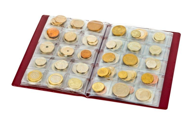 世界在册页的金钱硬币的汇集 库存图片