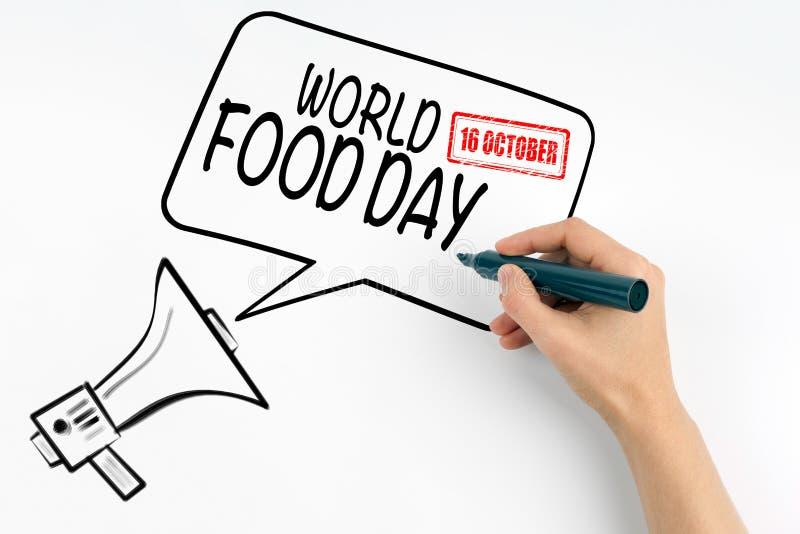 世界粮食日10月16日 扩音机和文本在白色背景 库存图片