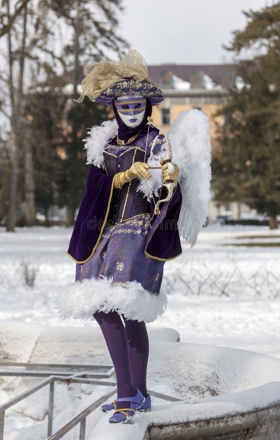 丘比特假装的人-阿讷西威尼斯式狂欢节2013年 库存照片