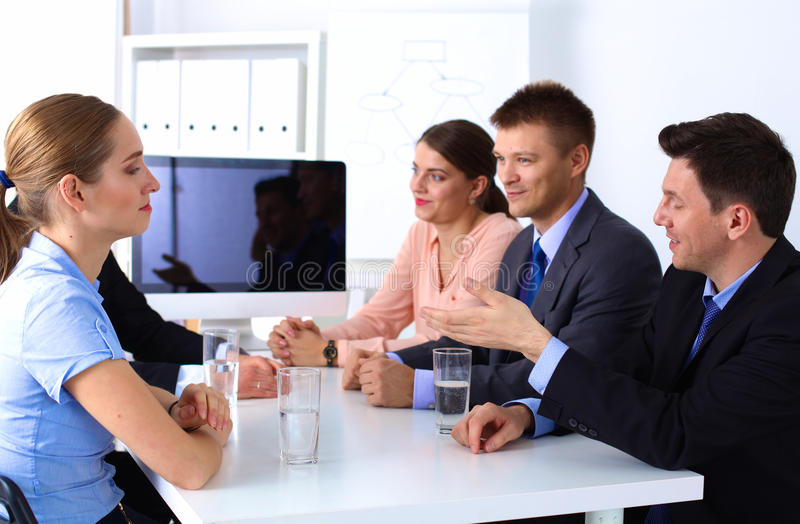 业务会议-经理谈论工作与 库存图片