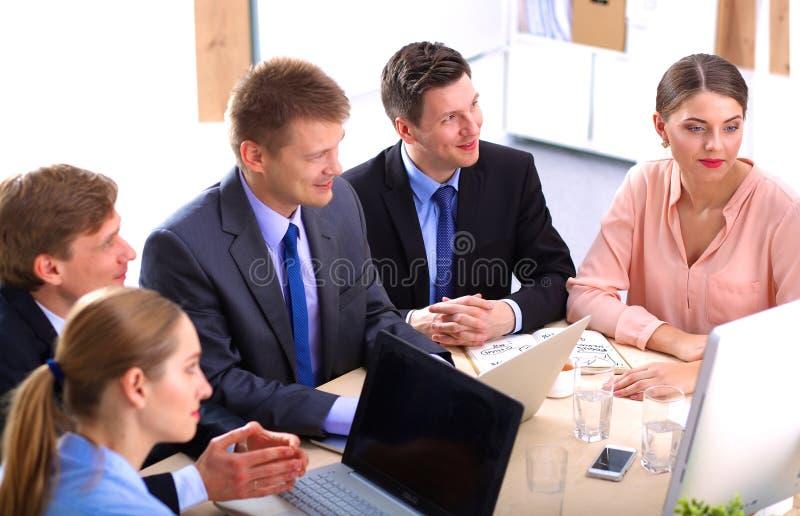 业务会议-经理谈论工作与 免版税图库摄影
