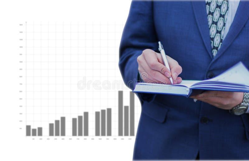 业务记录在商人的手上 图库摄影