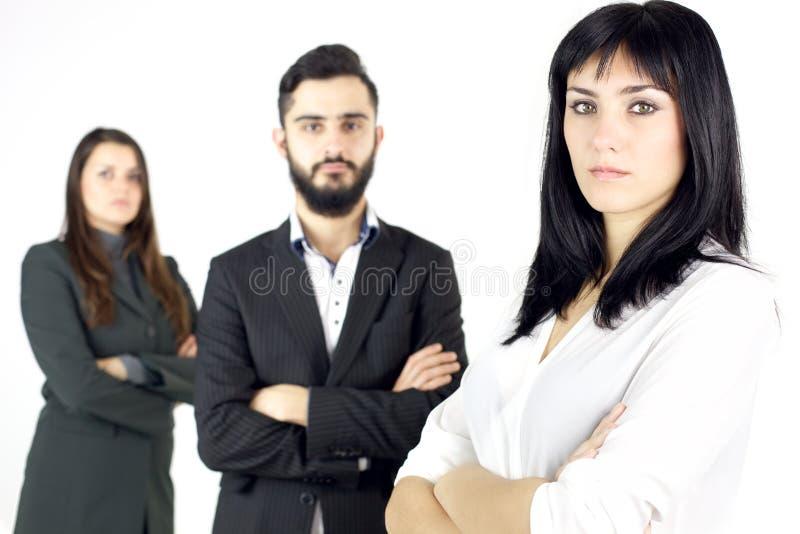 两个严肃的女商人和一个人被隔绝 免版税库存照片