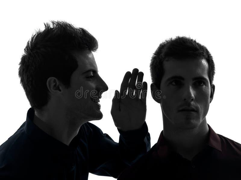 两个人双胞胎朋友影响概念剪影 免版税库存图片