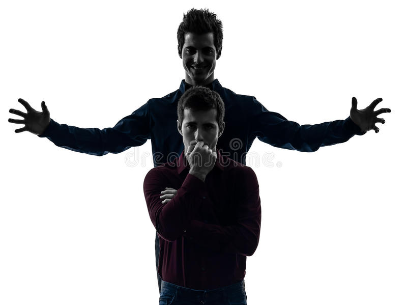 两个人双胞胎朋友控制权schyzophrenia概念s 免版税库存照片