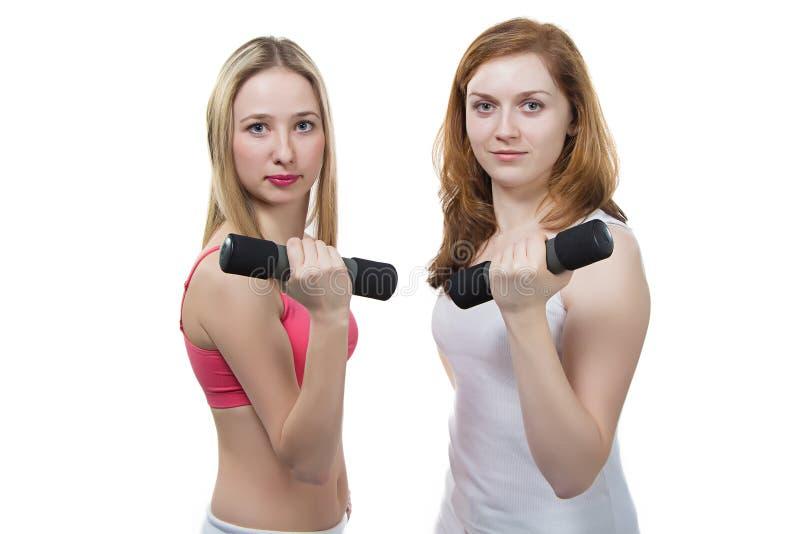 两个女孩做健身 免版税图库摄影