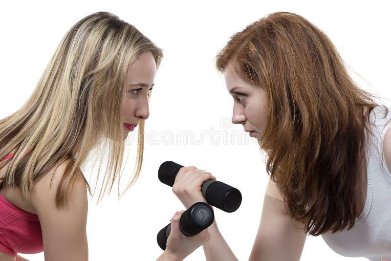 两个女孩做健身 库存图片