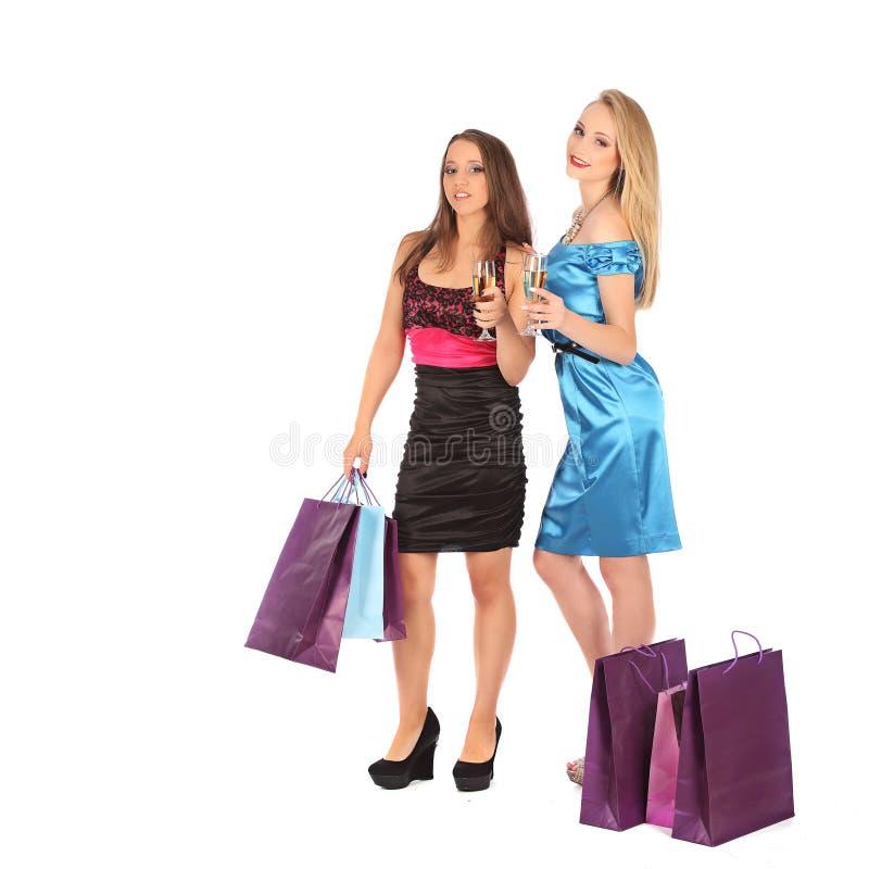两个女孩喝精神对selebrate一个优秀选择 免版税库存照片