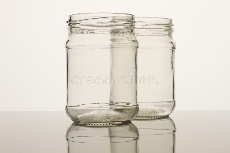 两个玻璃透明空的瓶子 免版税库存图片