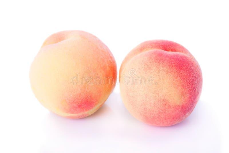 两个美味的桃子 免版税库存照片