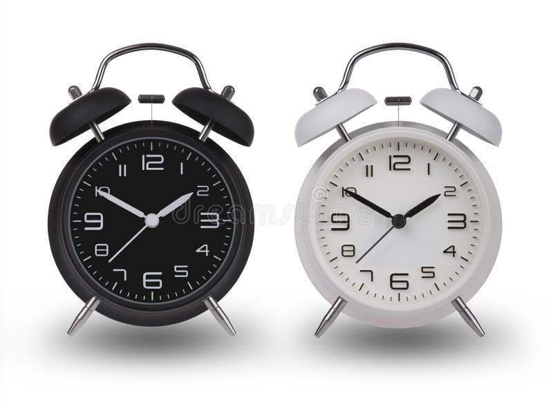 两个闹钟用在10和2的手 免版税库存图片