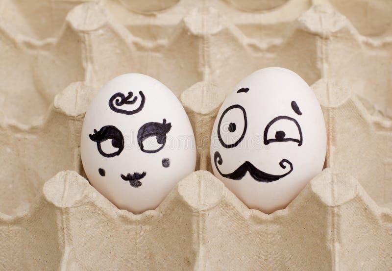 两个滑稽的被绘的鸡蛋、夫人和绅士 库存照片