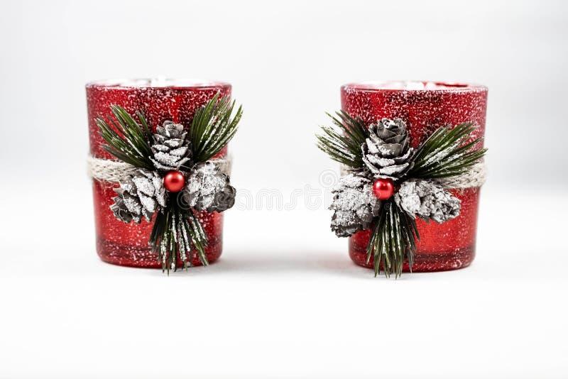 两件圣诞节蜡烛装饰品的图象 库存图片
