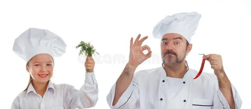 两位厨师父亲和小女儿 免版税库存照片
