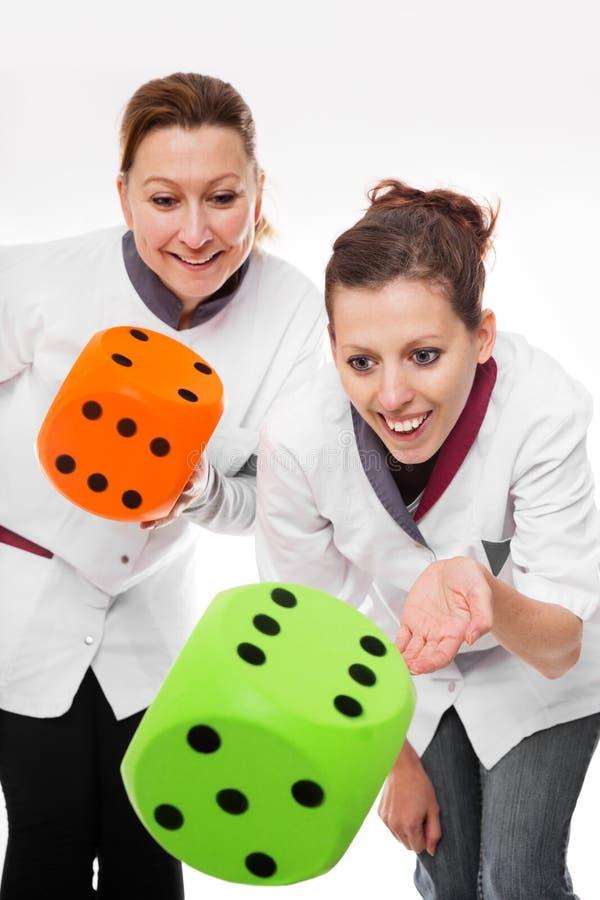 两位女性护士概念家庭护理 免版税图库摄影