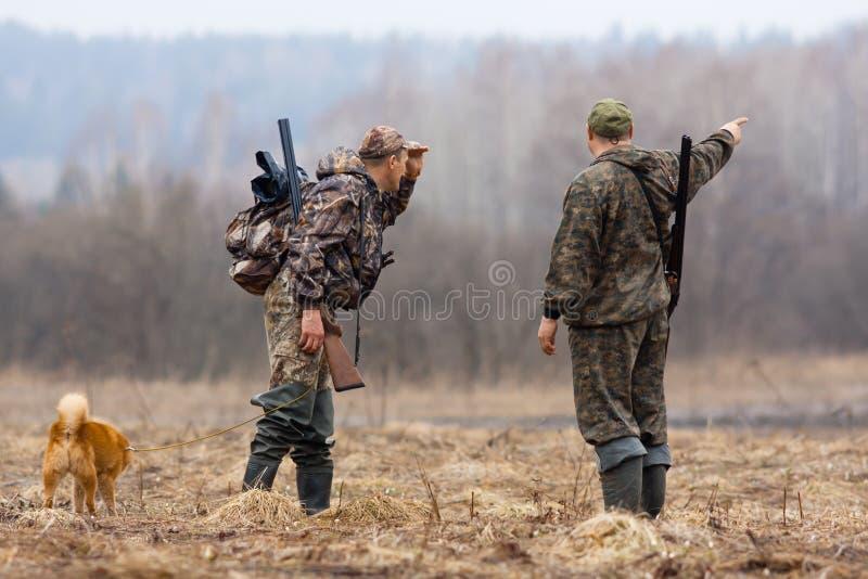两位猎人 库存照片