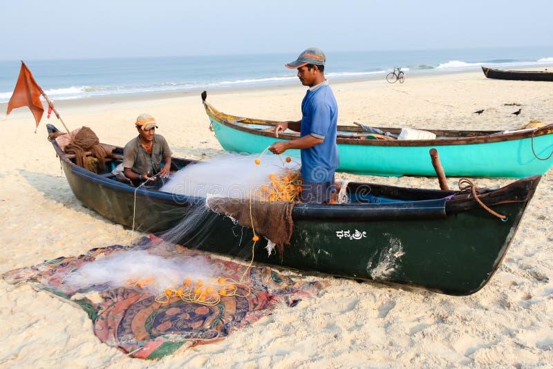 两位年轻渔夫 库存照片