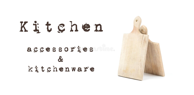 两使用了在与书面标志厨房辅助部件和厨具的白色背景隔绝的木切板 黑褐色lett 免版税图库摄影
