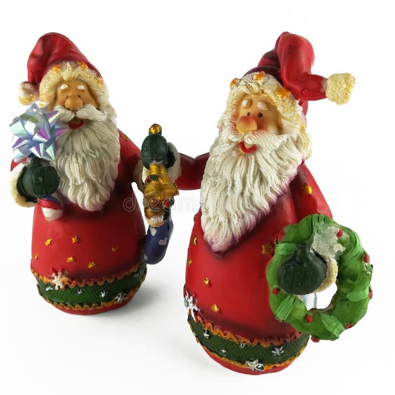 两圣诞老人圣诞节小雕象  免版税库存图片