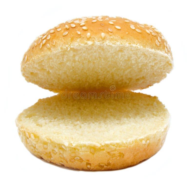 两在白色汉堡面包隔绝的一半 免版税图库摄影