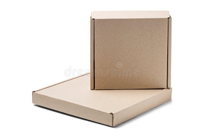 两在被隔绝的白色背景的纸板箱 与空的空间的小包您的文本的 交付或岗位服务的样式 免版税图库摄影