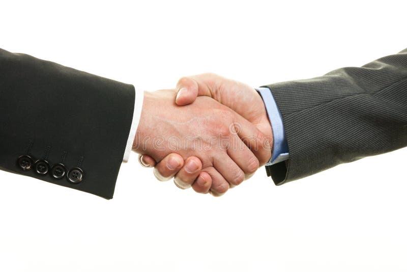 两握手的商人隔绝在白色背景 库存图片