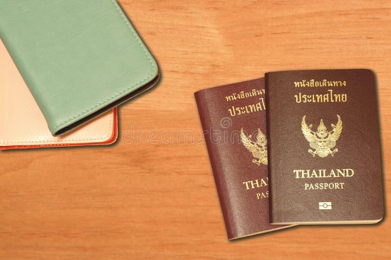 两本泰国护照和皮革护照盖子 免版税库存照片