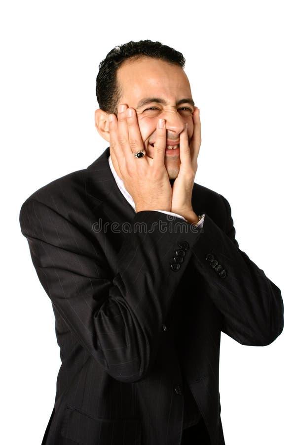两生意人覆盖物fa一半他的掌上型计算机 免版税库存照片