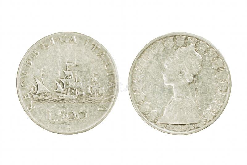 两银色意大利里拉硬币的边与哥伦布船的  Isol 库存图片