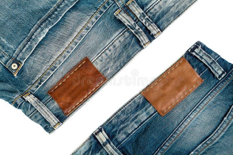两件牛仔裤,在白色背景 免版税库存照片