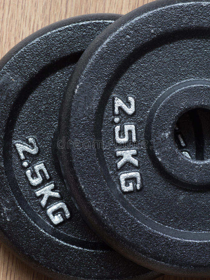 两2 5kg杠铃重量板材  库存图片