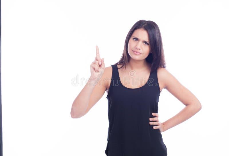 严肃和疑问年轻美丽的女孩 免版税库存照片
