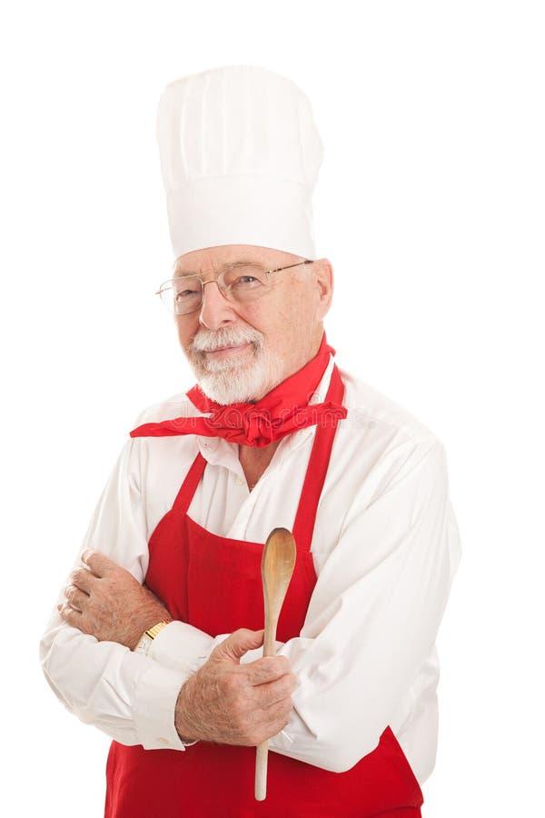 严肃的资深厨师 免版税库存照片