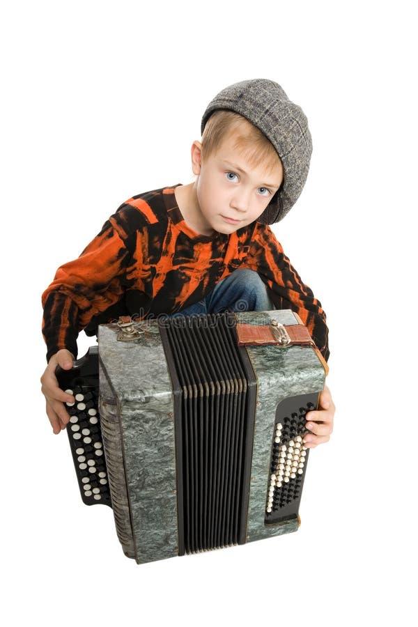 严重手风琴的男孩 图库摄影