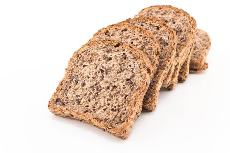 整个五谷面包发芽的麦子 库存图片