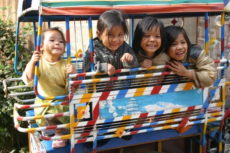 4个女孩愉快的老挝luang prabang年轻人 免版税图库摄影